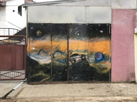 A Comrat mechanic attracts business with this galactic mural